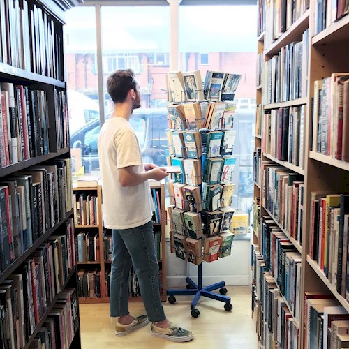Person looking at books in Dreadnought Books